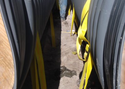 Mesquite St Storm Drainage - Corpus Christi, TX - Securing pipelines with strap and earth anchor systems