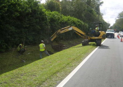 Reynoldswood Drive - Ehrlich Rd, Tampa, FL - Driving earth anchor into ground