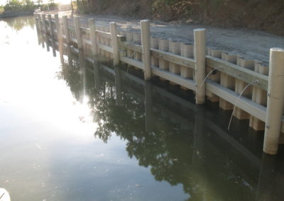 Vinyl Sheet Piling - Secured with B6 earth anchors