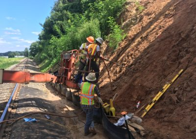 Installing ARGS anchors into the slope