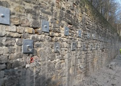 Active Plati-Drains® Removing Hydrostatic Pressure Behind a Retaining Wall